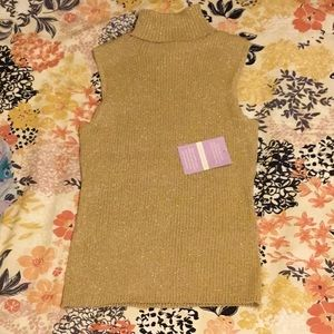 Cable and Gauge sleeveless gold turtleneck.